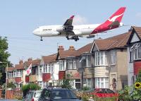 Plane landing at Heathrow Airport; photo by Adrian Pingstone, public domain