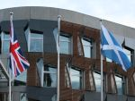 The Union Flag and Scottish Saltire flying in front of the Scottish Parliament building, Edinburgh